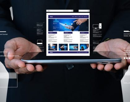 Male holding phone with website sitting on top